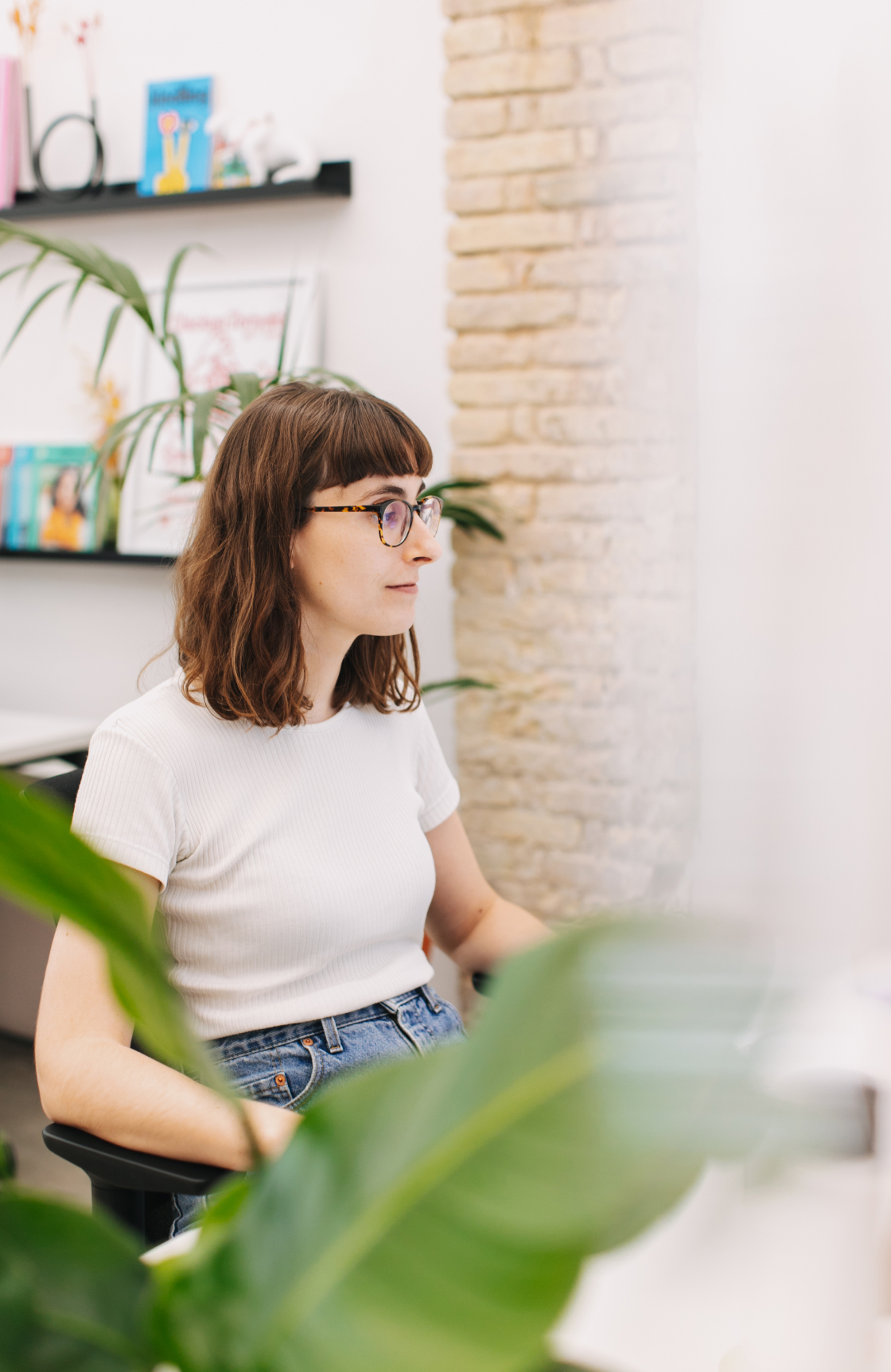 Person working on sofa with a laptop on their lap